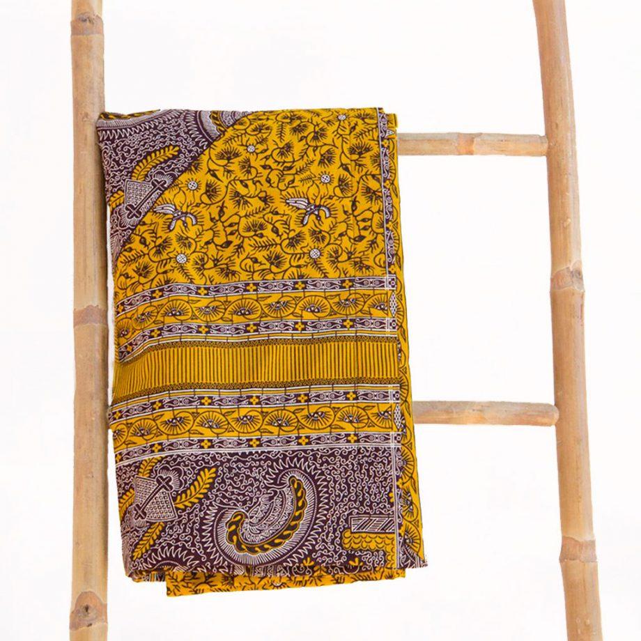 Toalla-playa-original-tela-wax-etnica-amarilla-marron-ukat